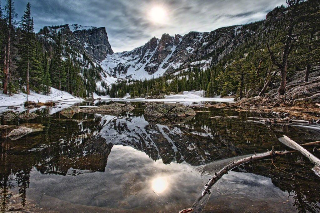 The sun sets behind Hallett Peak and Flattop Mountain, reflected in the appropriately named Dream Lake in Rocky Mountain National Park.